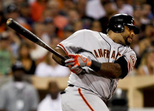 San Francisco Giants' Pablo Sandoval watches his RBI single against the San Diego Padres during the Giants' eight run third inning in a baseball game Friday, Aug. 17, 2012 in San Diego. (AP Photo/Lenny Ignelzi)