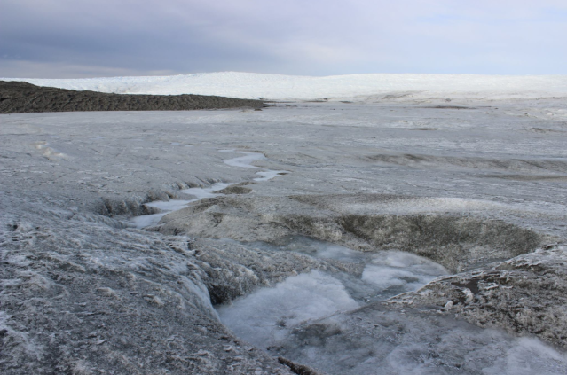 Meltwater flows from the face of the Russell Glacier, located about 16 miles east of Kangerlussuaq. The glacier serves as a popular attraction for scientists and tourists. (Alexander C Kaufman / HuffPost)