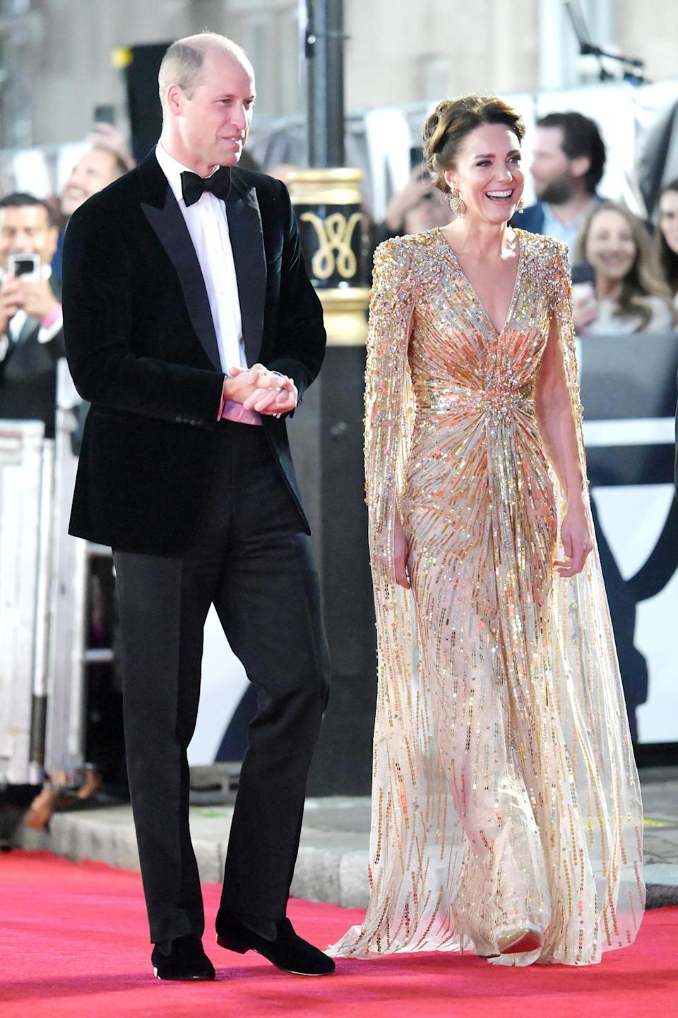 <p>For their big night out, Kate wore a gold, beaded Jenny Packham gown with a dramatic cape while William opted for a velvet jacket with satin lapels and black cashmere slippers by Arthur Sleep.</p>