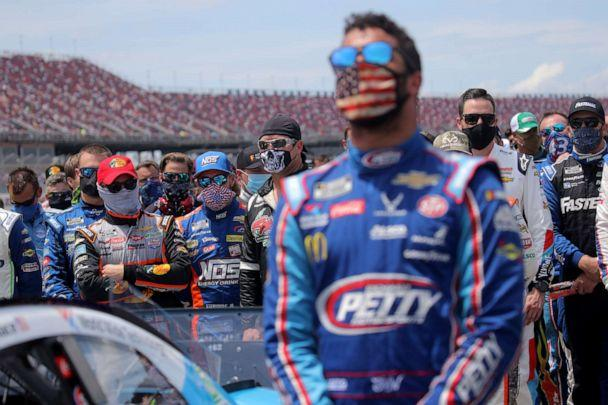 PHOTO: NASCAR drivers stand in solidarity with Bubba Wallace during the national anthem prior to the NASCAR Cup Series GEICO 500 at Talladega Superspeedway on June 22, 2020 in Talladega, Alabama. (Chris Graythen/Getty Images)