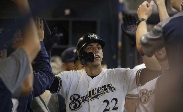 Milwaukee Brewers' Christian Yelich is congratulated after hitting a home run during the sixth inning of a baseball game against the Los Angeles Dodgers Saturday, July 21, 2018, in Milwaukee. (AP Photo/Morry Gash)