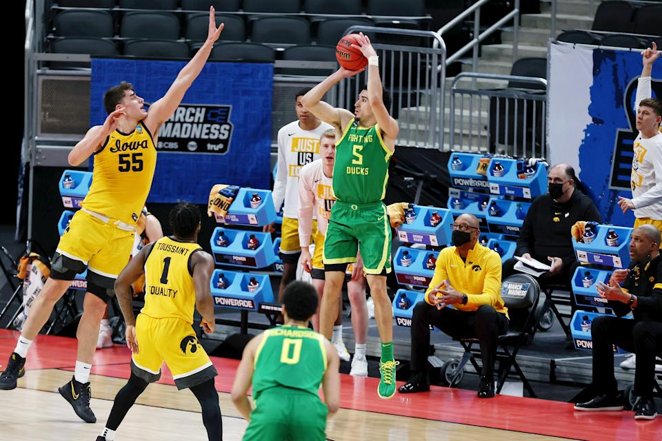 Mar 22, 2021; Indianapolis, Indiana, USA; Oregon Ducks guard Chris Duarte (5) shoots against Iowa Hawkeyes center Luka Garza (55) during the first half in the second round of the 2021 NCAA Tournament at Bankers Life Fieldhouse. Mandatory Credit: Trevor Ruszkowski-USA TODAY Sports