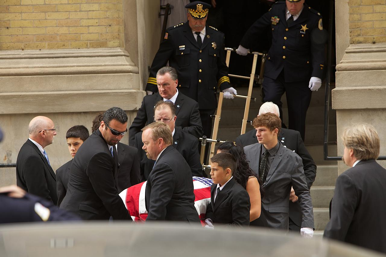 CHICAGO, IL - JULY 30: Late actor Dennis Farina's grandchildren serve as pallbearers during his Funeral Service at Assumption Catholic Church on July 30, 2013 in Chicago, Illinois. (Photo by Jeff Schear/Getty Images)