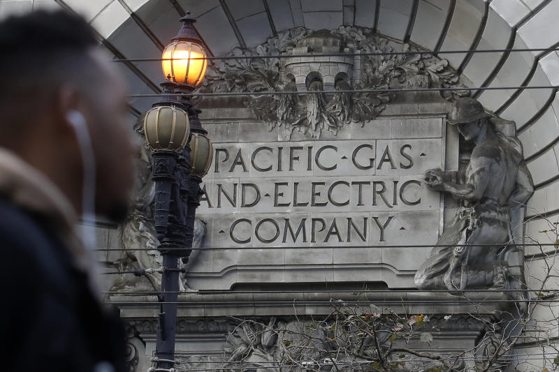 FILE - In this Dec. 16, 2019, file photo, a sign to a Pacific Gas & Electric building is shown in San Francisco. Pacific Gas & Electric is assuring a federal judge Wednesday, Jan. 29, 2020, it will meet a June 30 deadline for getting out of bankruptcy, as California Gov. Gavin Newsom signaled his intent to follow through on his threat to attempt a government takeover of the nation's largest utility. (AP Photo/Jeff Chiu, File)