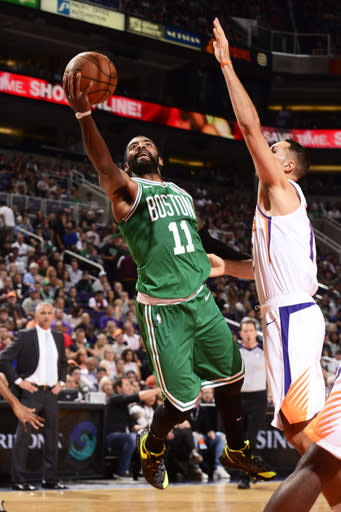 PHOENIX, AZ - NOVEMBER 8: Kyrie Irving #11 of the Boston Celtics goes to the basket against the Phoenix Suns on November 8, 2018 at Talking Stick Resort Arena in Phoenix, Arizona. (Photo by Barry Gossage/NBAE via Getty Images)