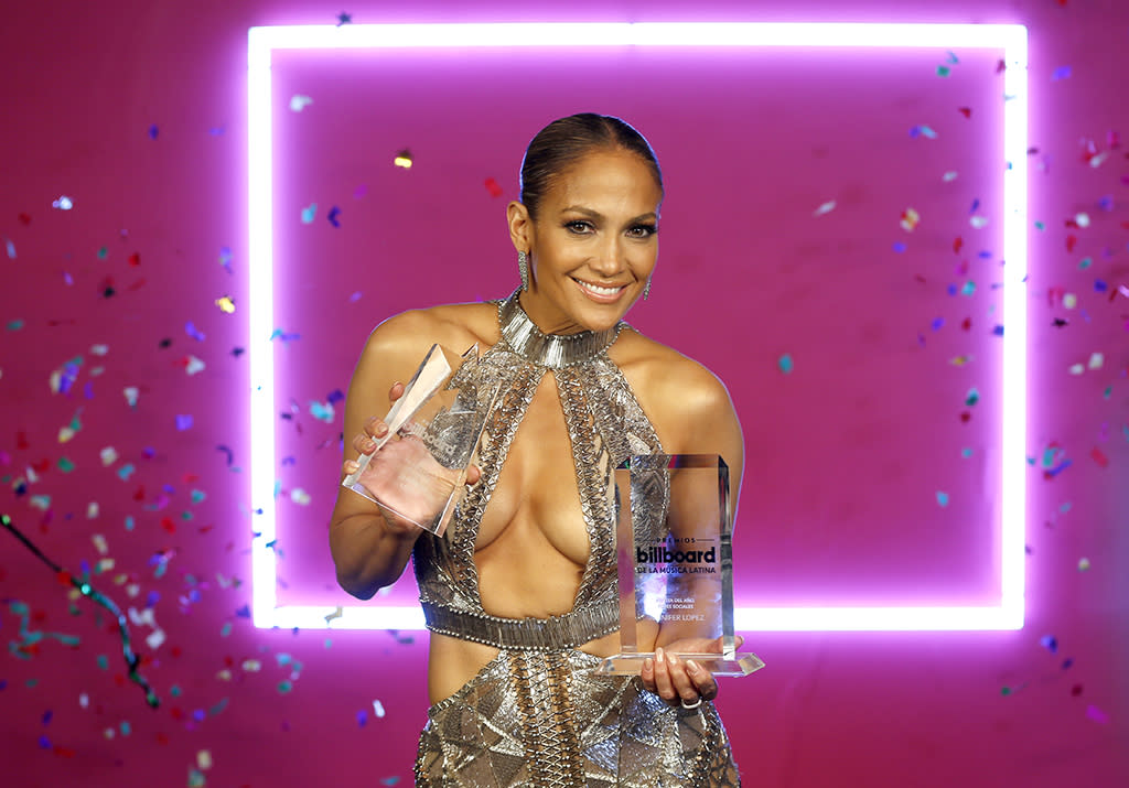 <p>While it sometimes seems that J.Lo's full-time job is to adore her new boyfriend, Alex Rodriguez, she has a pretty good thing going in music. The singer took home two trophies at the Billboard Latin Music Awards in Miami. (Photo: AP Photo/Wilfredo Lee) </p>