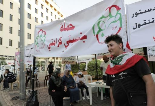"Omar, a 17-year-old activist helps at Lebanon's ""My Nationality, My Dignity"" campaign booth during anti-government demonstrations in downtown Beirut"