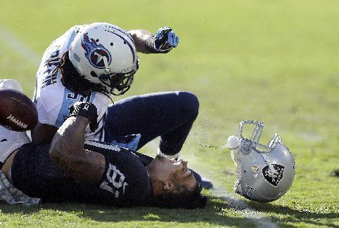 Oakland Raiders tight end Mychal Rivera (81) loses his helmet after being hit by Tennessee Titans free safety Michael Griffin during the second quarter of an NFL football game in Oakland, Calif., Sunday, Nov. 24, 2013. Griffin was penalized on the play and Rivera stayed down for a few minutes before walking off under his own power. He was taken to the locker room and is being evaluated for a head injury. (AP Photo/Ben Margot)