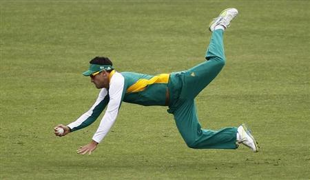 South Africa's Faf du Plessis dives to catch the ball during a cricket practice session in Mohali March 2, 2011. REUTERS/Adnan Abidi/Files