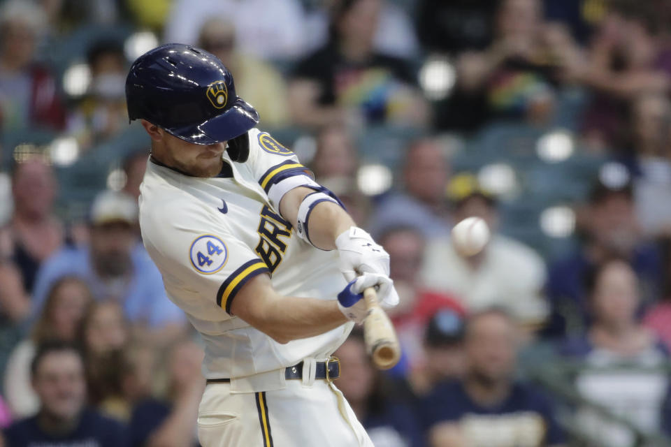 Milwaukee Brewers' Eric Lauer hits an RBI- sacrifice fly during the second inning of a baseball game against the Cincinnati Reds, Monday, June 14, 2021, in Milwaukee. (AP Photo/Aaron Gash)