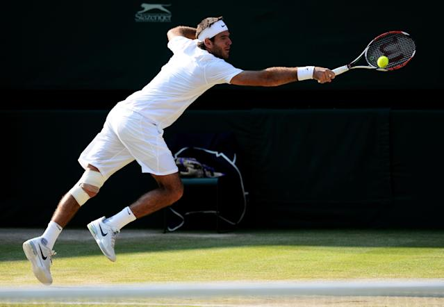 LONDON, ENGLAND - JULY 05: Juan Martin Del Potro of Argentina stretches to play a backhand during the Gentlemen's Singles semi-final match against Novak Djokovic of Serbia on day eleven of the Wimbledon Lawn Tennis Championships at the All England Lawn Tennis and Croquet Club on July 5, 2013 in London, England. (Photo by Mike Hewitt/Getty Images)