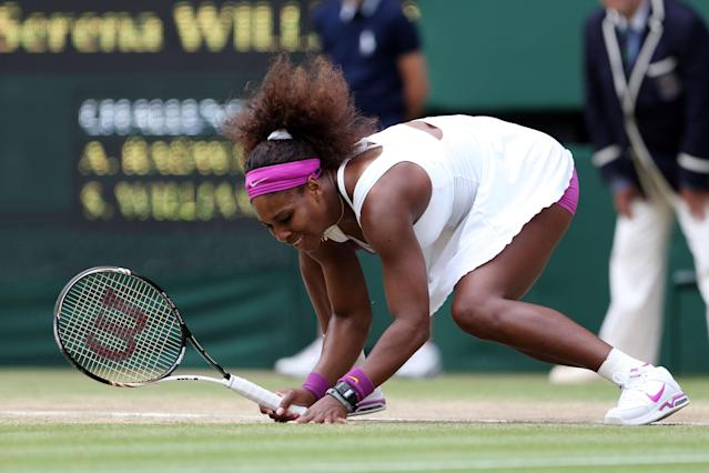 LONDON, ENGLAND - JULY 07: Serena Williams of the USA slips to the ground during her Ladies? Singles final match against Agnieszka Radwanska of Poland on day twelve of the Wimbledon Lawn Tennis Championships at the All England Lawn Tennis and Croquet Club on July 7, 2012 in London, England. (Photo by Julian Finney/Getty Images)