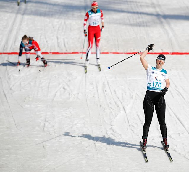 Cross-Country Skiing - Pyeongchang 2018 Winter Paralympics - Women's 1.5km Sprint Classic - Standing - Final - Alpensia Biathlon Centre - Pyeongchang, South Korea - March 14, 2018 - Anna Milenina, a Paralympic Athlete from Russia, celebrates winning the gold. REUTERS/Carl Recine