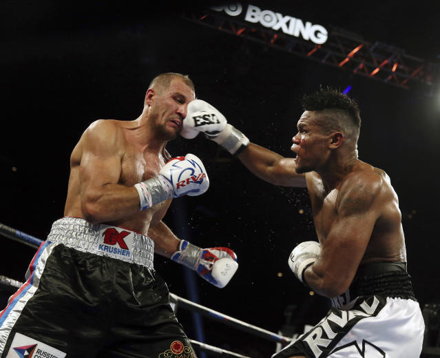 Eleider Alvarez, of Colombia, connects a punch to Sergey Kovalev, of Russia, during the seventh round of their 175-pound boxing bout Saturday, Aug. 4, 2018, in Atlantic City, N.J. alvarez won by knockout in the seventh round. (AP Photo/Mel Evans)