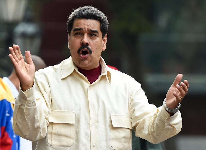Venezuelan President Nicolas Maduro, pictured in Caracas on April 19, 2016, is at the midpoint in his six-year term and faces an emboldened opposition as the country is mired in economic chaos (AFP Photo/Juan Barreto)