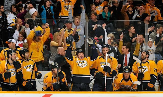 NASHVILLE, TN - NOVEMBER 25: Matt Hendricks #26 of the Nashville Predators celebrates with teammates and fans after a goal against the Phoenix Coyotes at Bridgestone Arena on November 25, 2013 in Nashville, Tennessee. (Photo by Frederick Breedon/Getty Images)