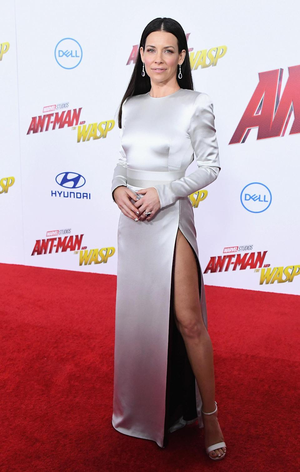 <p>For the premiere of 'Ant-Man and the Wasp' on June 25, actress Evangeline Lilly wore a silky thigh-split dress by August Getty Atelier. She finished the red carpet look with Kallati jewellery. [Photo: Getty] </p>