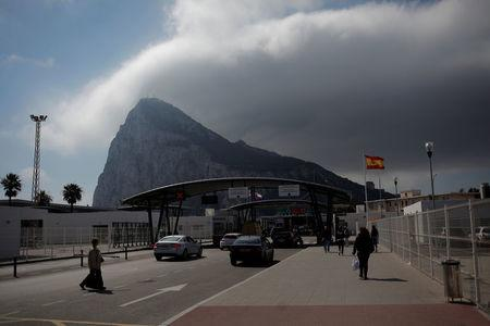 People enter the British territory of Gibraltar, historically claimed by Spain, at its border with Spain, in La Linea de la Concepcion