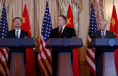 U.S. Secretary of State Mike Pompeo and Defense Secretary James Mattis listen to Chinese Communist Party Office of Foreign Affairs Director Yang Jiechi speak as they hold a joint media news conference after participating in a second diplomatic and security meeting at the U.S. Department of State, Washington, U.S., November 9, 2018. REUTERS/Leah Millis