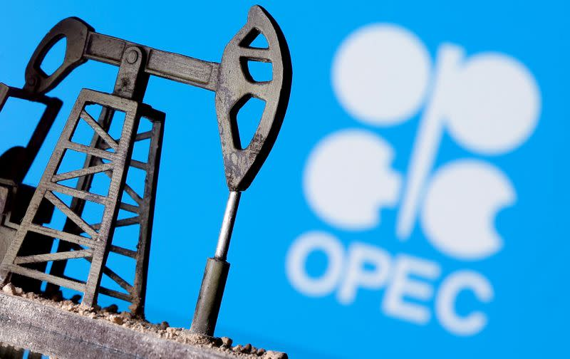 FILE PHOTO: A 3D printed oil pump jack in front of the OPEC logo