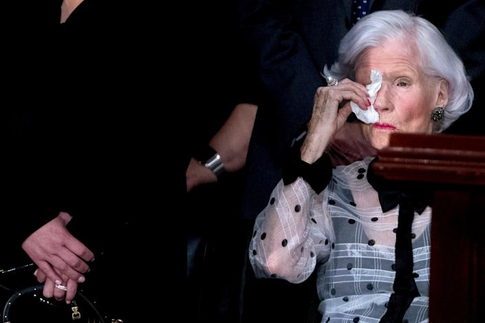 Roberta McCain, mother of the late senator, wipes her eyes as she looks at his casket.
