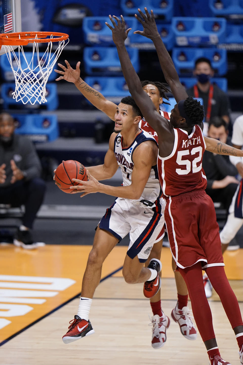 Gonzaga guard Jalen Suggs (1) shoots in front of Oklahoma forward Kur Kuath (52) in the second half of a college basketball game in the second round of the NCAA tournament at Hinkle Fieldhouse in Indianapolis, Monday, March 22, 2021. (AP Photo/AJ Mast)