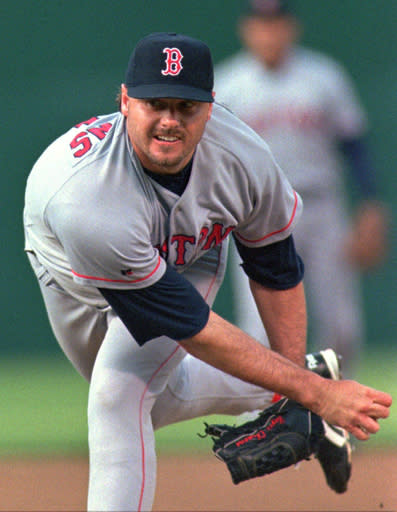 FILE - In this May 28, 1996, file photo, Boston Red Sox's Roger Clemens releases a pitch against the Oakland Athletics during a baseball game in Oakland, Calif., Coliseum. The Hall of Fame wont have any new players in the class of 2021 after voters decided no one had the merits on-the-field or off for enshrinement in Cooperstown on this year's ballot. Curt Schilling, Barry Bonds and Clemens were the closest in voting by members of the Baseball Writers' Association of America released Tuesday, and the trio will have one more chance at election next year. It's the first time the BBWAA didn't choose anyone since 2013. (AP Photo/Ben Margot, File)