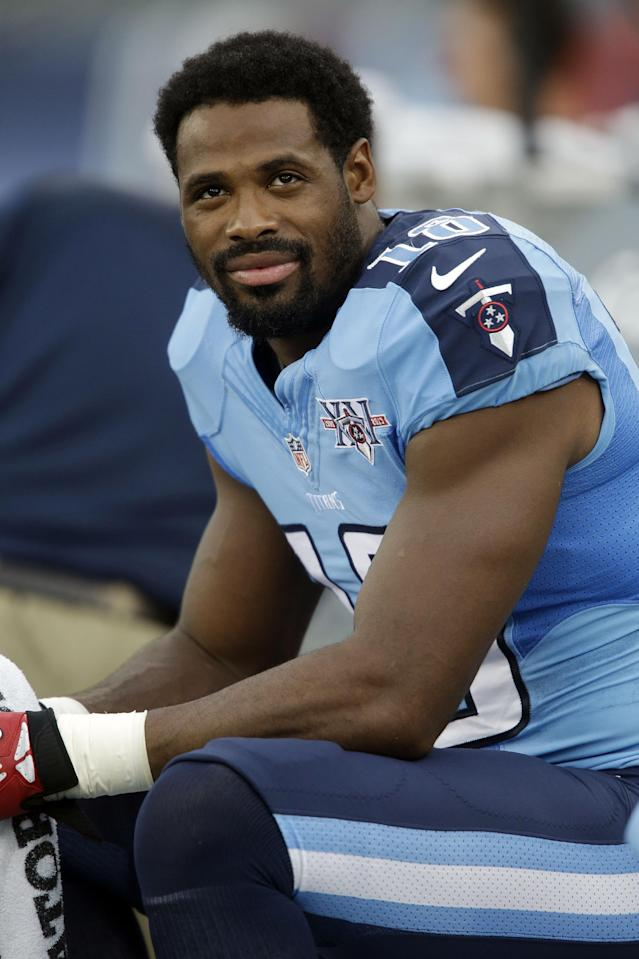 In this Aug. 8, 2013 photo, Tennessee Titans wide receiver Kenny Britt looks at the scoreboard during a preseason NFL football game against the Washington Redskins in Nashville, Tenn. This was supposed to be the season Britt finally broke through as a top receiver after knee injuries the past two years, but now he may be running out of time. (AP Photo/Wade Payne)