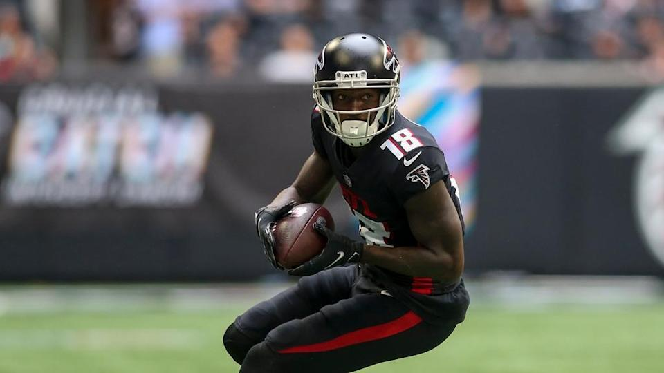 Calvin Ridley runs with ball in black Falcons jersey