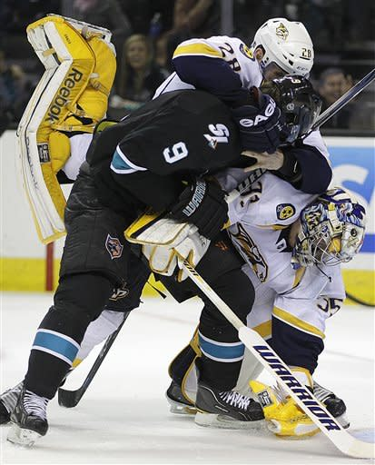 Nashville Predators' Paul Gaustad (28) and goalie Pekka Rinne, right, fight with San Jose Sharks' Martin Havlat (9) during the second period of an NHL hockey game Thursday, March 15, 2012, in San Jose, Calif. (AP Photo/Ben Margot)