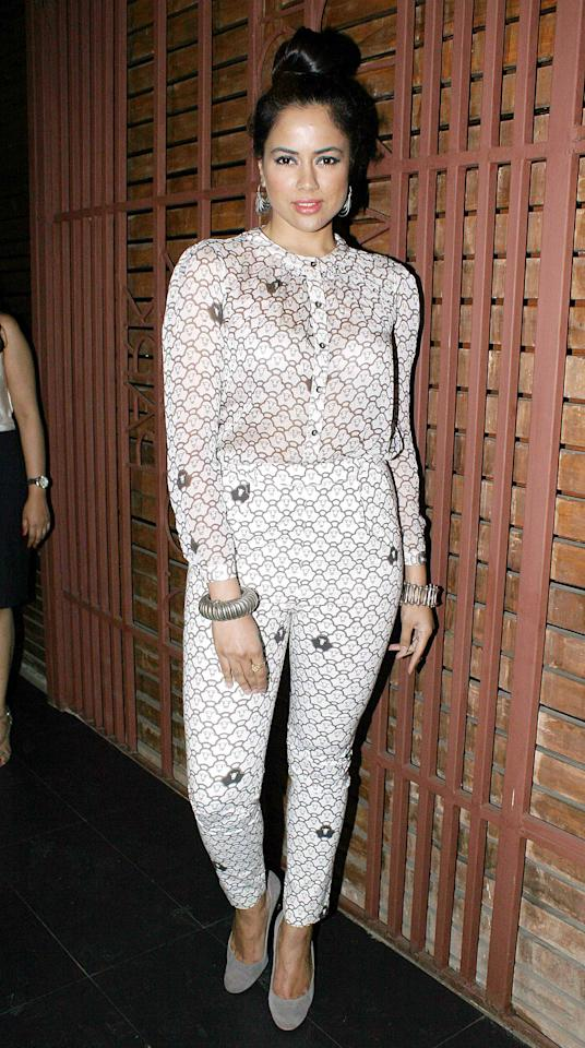 Sameera looking edgy in her printed nude jumpsuit and high bun.