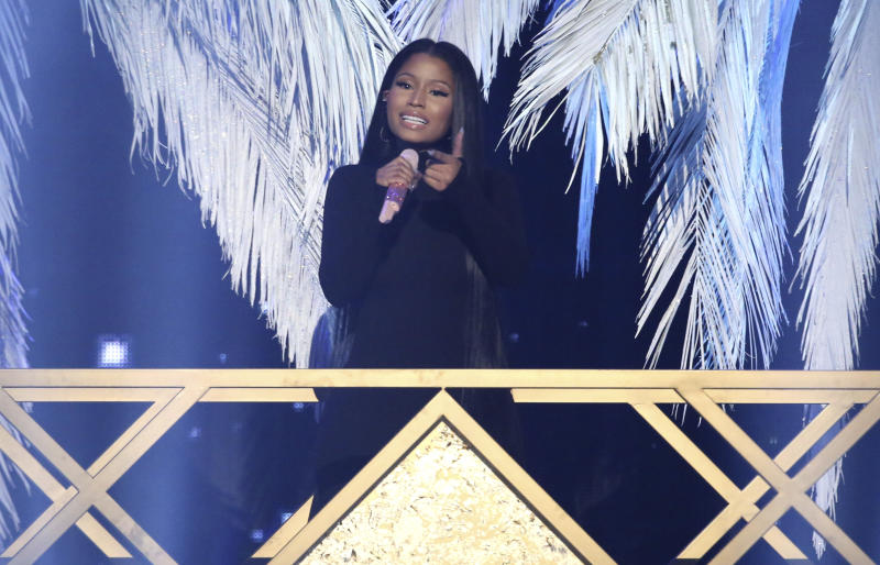 "FILE - In this Nov. 20, 2016 file photo, Nicki Minaj performs ""Do You Mind"" at the American Music Awards at the Microsoft Theater  in Los Angeles.  The Wilhelmina talent and modeling agency has signed Nicki Minaj to its celebrity division. The agency said in a statement Wednesday, March 29, 2017 it will work to further the six-time American Music Award winner's influence in fashion and beauty. (Photo by Matt Sayles/Invision/AP)"