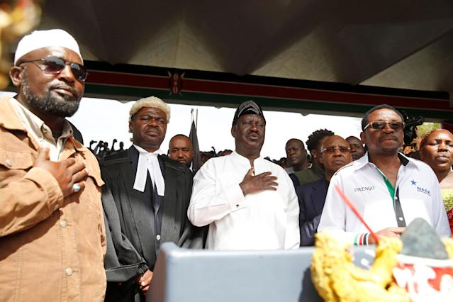 <p>Kenyan opposition leader Raila Odinga of the National Super Alliance (NASA) stands for the national anthem before taking a symbolic presidential oath of office in Nairobi, Kenya, Jan. 30, 2018. (Photo: Baz Ratner/Reuters) </p>