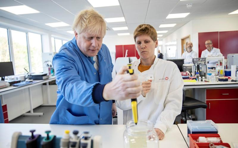 Boris Johnson visiting the lab developing the tests earlier this month - Jack Hill/Reuters
