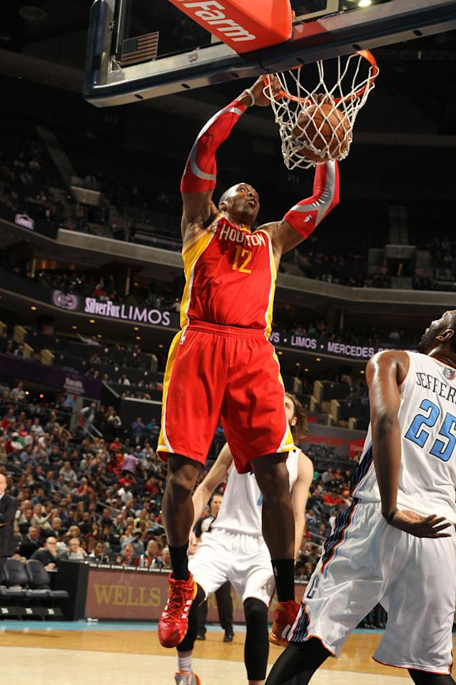 CHARLOTTE, NC - MARCH 24: Dwight Howard #12 of the Houston Rockets dunks against the Charlotte Bobcats during the game at the Time Warner Cable Arena on March 24, 2014 in Charlotte, North Carolina. (Photo by Kent Smith/NBAE via Getty Images)