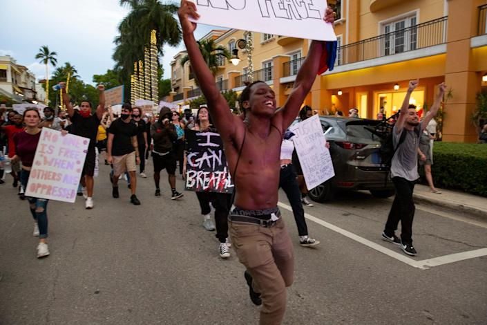 Protesters make their way down Naples' 5th Avenue South on Monday, June 1, 2020.