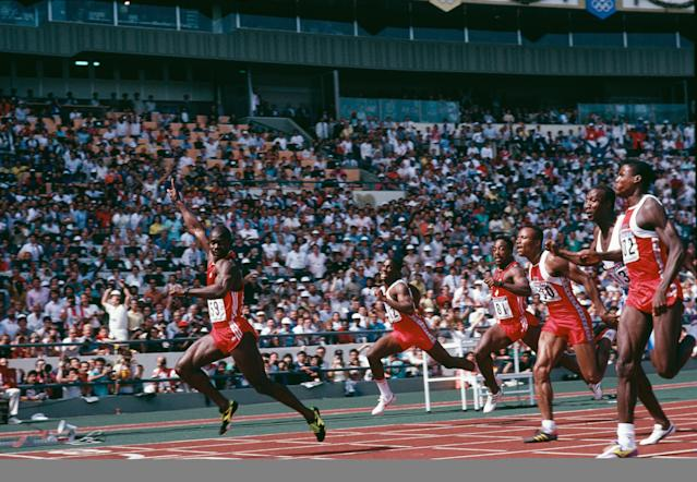 Canadian sprinter Ben Johnson (left) wins the 100 metres final at the Seoul Olympics, 24th September 1988. However he was later disqualified when traces of anabolic steroid were found in his urine. American athlete Carl Lewis, who was subsequently awarded the gold medal, is also pictured (far right). (Photo by Simon Bruty/Getty Images)
