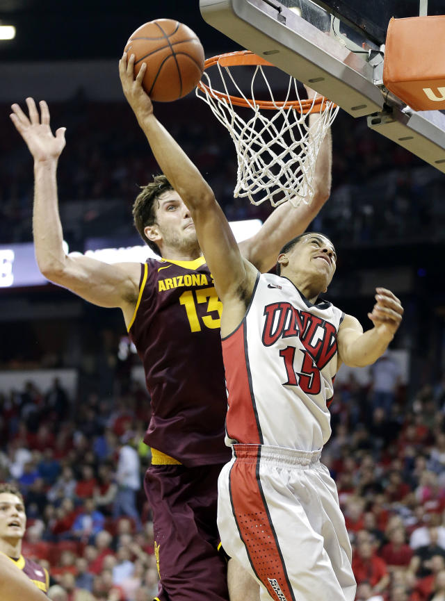 UNLV's Kendall Smith shoots covered by Arizona State's Jordan Bachynski, of Canada, during the second half of an NCAA college basketball game on Tuesday, Nov. 19, 2013, in Las Vegas. Arizona State defeated UNLV 86-80. (AP Photo/Isaac Brekken)
