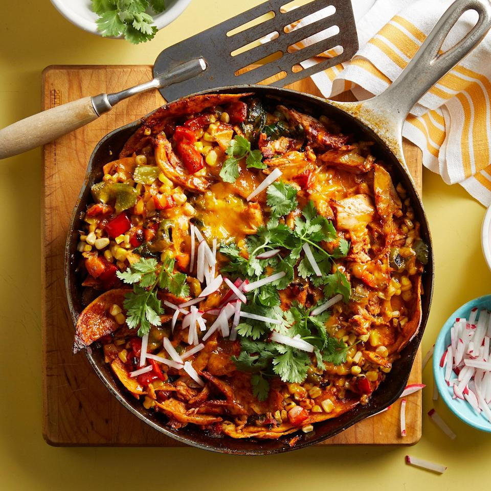 <p>This simplified take on cheesy chicken enchiladas only requires one pan for cooking and eliminates the need to stuff and roll corn tortillas. Charring the veggies in a cast-iron skillet adds depth of flavor. Don't worry if you don't have one, because you can use any oven-safe skillet instead.</p>