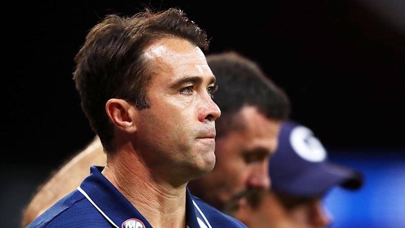 Pictured here, Geelong coach Chris Scott is happy to do what he's told about COVID-19.