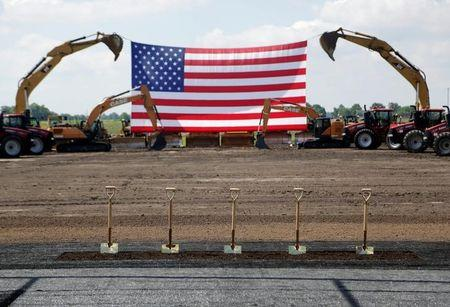 Heavy machinery and the American flag are seen before the arrival of U.S. President Donald Trump as he participates in the Foxconn Technology Group groundbreaking ceremony for its LCD manufacturing campus