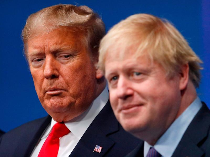 Britain's Prime Minister Boris Johnson (R) welcomes US President Donald Trump (L) to the NATO summit: AFP via Getty Images