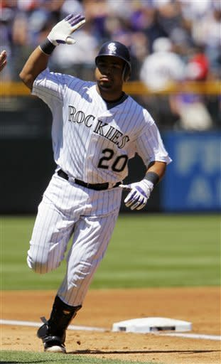 Colorado Rockies' Wilin Rosario circles the bases after hitting a two-run home run off Houston Astros starting pitcher Wandy Rodriguez in the first inning of game one of a day/night doubleheader in Denver on Monday, May 28, 2012. (AP Photo/David Zalubowski)