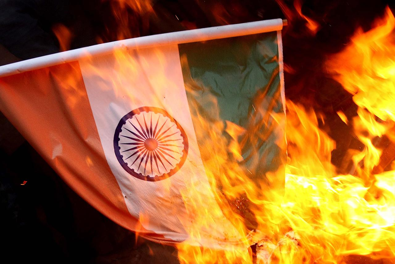 <p>People burn a mock of an Indian flag during a protest against India, in Karachi, Pakistan, Nov. 16, 2016. (Photo: SHAHZAIB AKBER/EPA) </p>