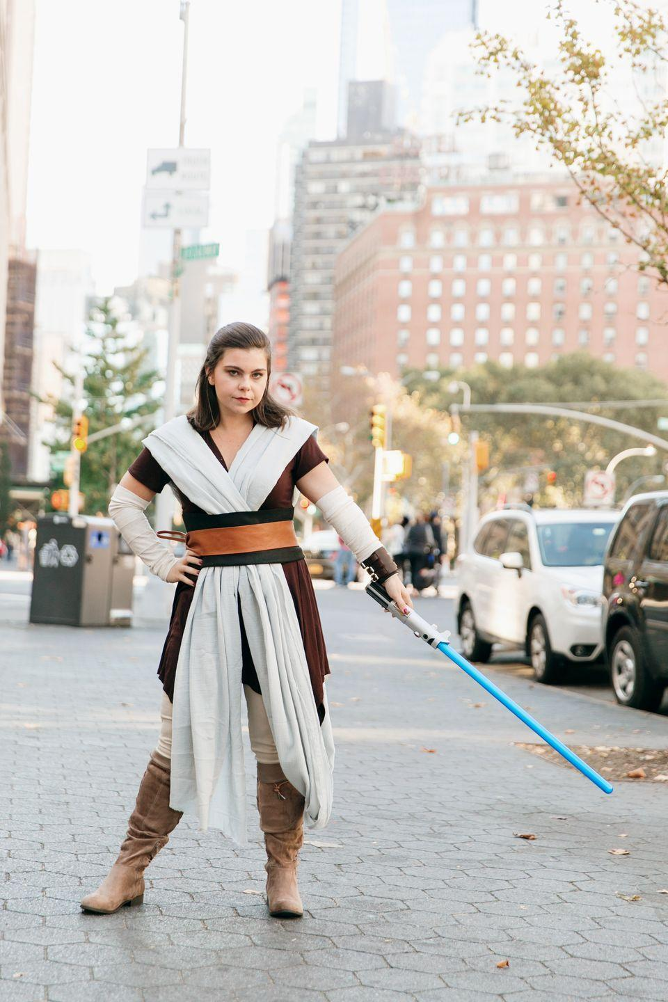 """<p><em>Star Wars</em> fans, we hope you're sitting down for this news: You too can transform into Rey this year. This DIY costume requires nothing more than a bit of white fabric, which you can use to craft makeshift armbands, plus a lightsaber, a brown tunic, and a pair of slouchy riding boots. A brown belt ties it all together.</p><p><a class=""""link rapid-noclick-resp"""" href=""""https://www.amazon.com/Rubies-Costume-Obi-Wan-Kenobi-Accessory/dp/B00160GPMK/?tag=syn-yahoo-20&ascsubtag=%5Bartid%7C10050.g.4571%5Bsrc%7Cyahoo-us"""" rel=""""nofollow noopener"""" target=""""_blank"""" data-ylk=""""slk:SHOP LIGHT SABERS"""">SHOP LIGHT SABERS</a><br><br></p>"""