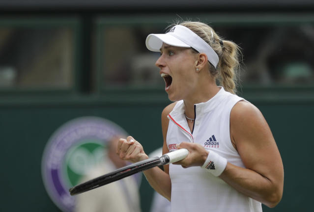Germany's Angelique Kerber celebrates winning her women's singles quarterfinals match against Russia's Daria Kasatkina, at the Wimbledon Tennis Championships, in London, Tuesday July 10, 2018. (AP Photo/Ben Curtis)