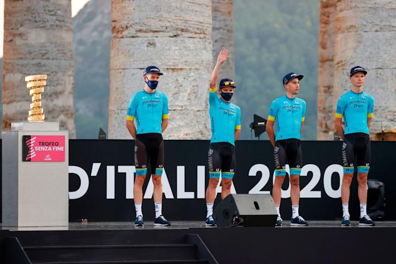 Riders of Astana Pro Team pose on stage at the Doric Temple of Segesta near Palermo Sicily on October 1 2020 during an opening ceremony of presentation of participating teams and riders two days ahead of the departure of the Giro dItalia 2020 cycling race Photo by Luca Bettini AFP Photo by LUCA BETTINIAFP via Getty Images
