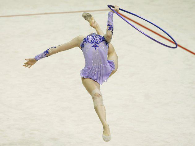 Loukia Trikomiti of Cyprus performs with the ball during the qualifying round of the the Rhythmic Gymnastics World Championships in Ise, Mie prefecture, central Japan September 9, 2009. (REUTERS/Issei Kato)