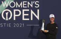 Sweden's Anna Nordqvist poses for the media holding the trophy after winning the Women's British Open golf championship, during the presentation ceremony in Carnoustie, Scotland, Sunday, Aug. 22, 2021. (AP Photo/Scott Heppell)