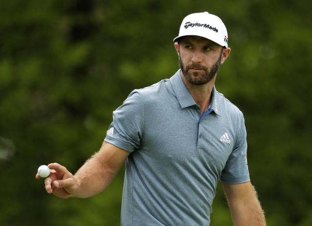 Dustin Johnson reacts after sinking a putt on the third green during the final round of the PGA Championship golf tournament, Sunday, May 19, 2019, at Bethpage Black in Farmingdale, N.Y. (AP Photo/Julio Cortez)